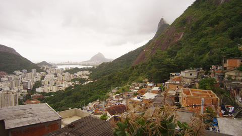 Slow panning shot over a favela and lagoon in Rio de Janeiro, Brazil Footage