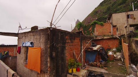 Tilting dolly shot of homes in a favela in Rio de Janeiro, Brazil Footage