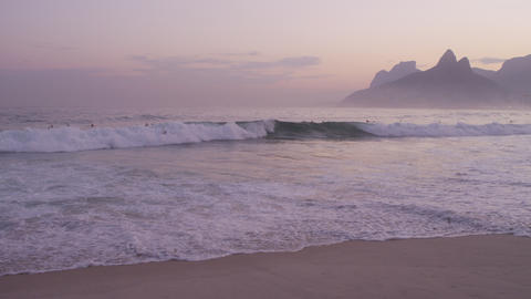 Sunset surfers with Rio, Brazil in background Footage