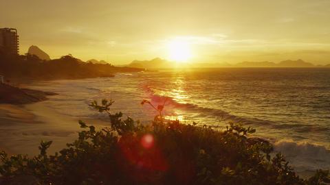 A lens flare pan shot taken along the beach in Rio de Janeiro Footage