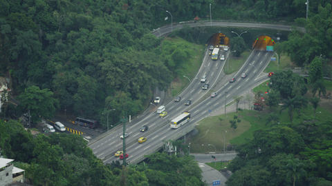 Steady daytime traffic at a tunneled intersection in Rio de Janeiro Footage