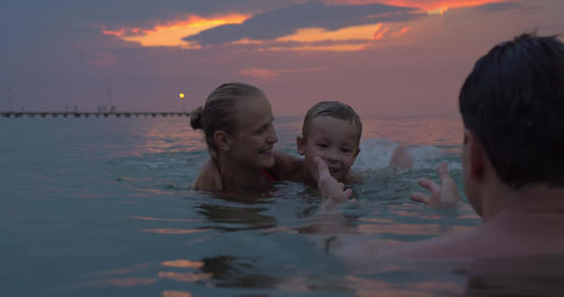 Happy family bathing in the dusk Footage