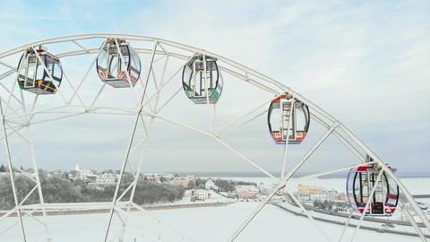 Chebeksary, Russia - December 20, 2018: a ferris wheel on the square, aerial Live Action