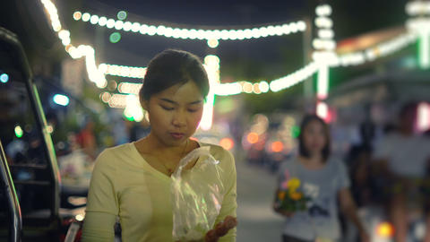Young Asian Girl eating street food in night Footage