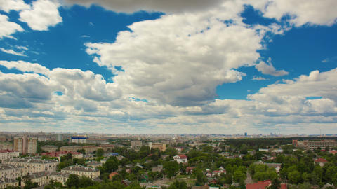 Time lapse of clouds moving above city Footage