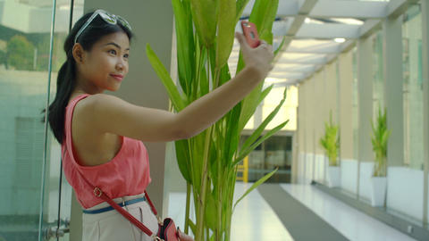 Young Girl making selfie photo on smartphone in office building Footage