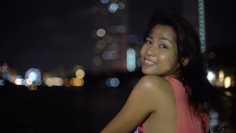 Happy Asian woman on a boat while night river cruise Footage
