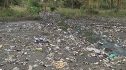 Zoom in of a poluted river Footage