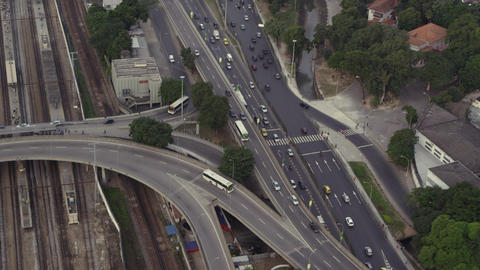 Aerial footage of train tracks and highway Footage