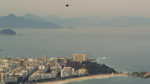Aerial pan shot of Rio de Janeiro, Brazil urbanscape and the Atlantic Ocean Live Action