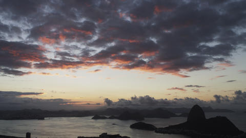 Downward, low light show ot sky, sea, and mountains outside Rio de Janeiro, Braz Footage