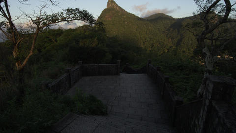Panning shot of stone walkway to Christ statue in Rio de Janeiro Footage