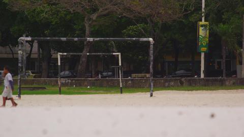 Slow motion shot of a park along a street in Rio de Janeiro, Brazil Footage