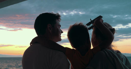Happy family with child enjoying sunset Footage