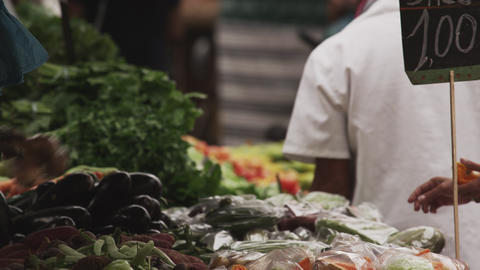 Slow motion shot of people buying produce in a market in Rio de Janeiro, Brazil Footage
