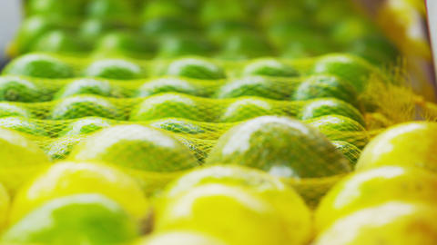 Racking close-up focus of green mandarin oranges at a market in Rio de Janeiro,  Footage