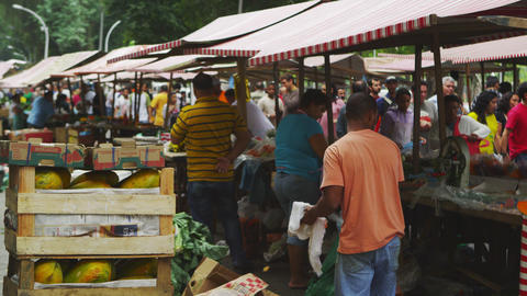 RIO DE JANEIRO, BRAZIL - JUNE 23: Slow motion of vendors in market on June 23, 2 Footage