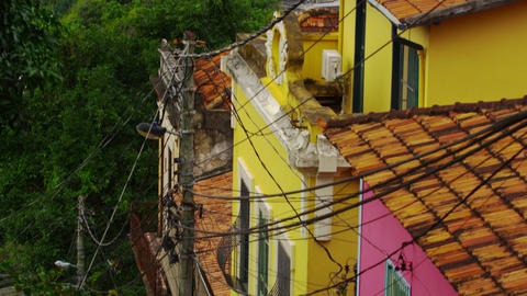 Tilting shot of a middle class neighborhood and a favela in Rio de Janeiro, Braz Footage