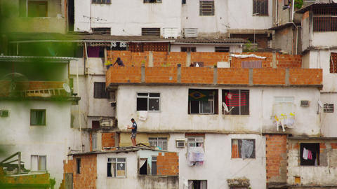 RIO DE JANEIRO, BRAZIL - JUNE 23: Slow motion of people on rooftops in favela Ri Footage