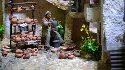 Largest animated nativity scene in South America. Potter makes pots from clay on Live Action
