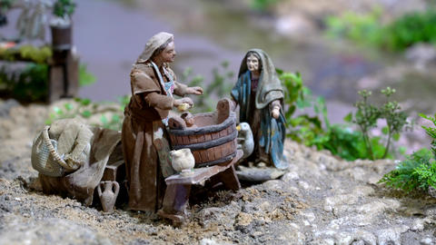 Largest animated nativity scene in South America. Woman gives baby a bath in a Footage