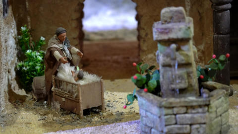 Largest animated nativity scene in South America. Woman picks baby up out of Footage