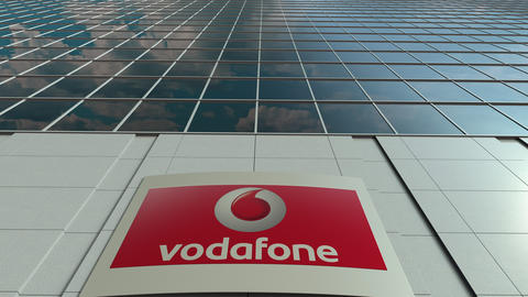 Signage board with Vodafone logo. Modern office building facade time lapse Live Action