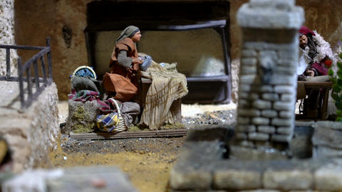 Largest animated nativity scene in South America. Woman irons clothes Live Action