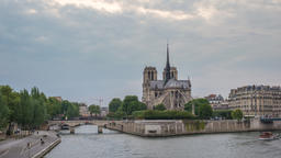 Paris France time lapse 4K, city skyline day to night timelapse at Notre Dame de Footage