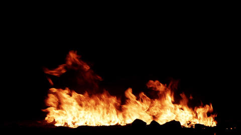 Lit a large fire at night on a black background 1280x720 Live Action