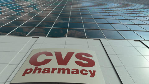 Signage board with CVS Health logo. Modern office building facade time lapse Footage