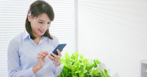 business woman use smart phone ビデオ