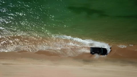 Aerial top down view of off-road vehicles rides on the water 영상물