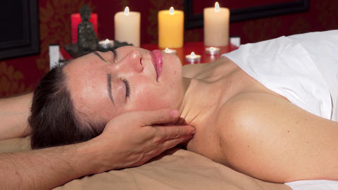 Happy attractive woman smiling to the camera after relaxing neck massage ビデオ