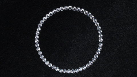 Rotation of a circle made of silver rhinestones, the symbol of infinity. Top Footage