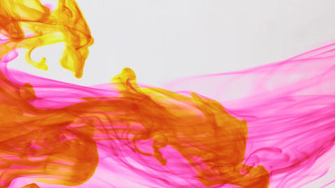 Yellow and pink colored paints mixed in water. Chaotic ライブ動画