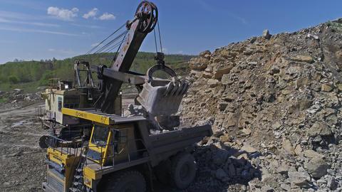 Excavator Loads Stones into a Dump Truck Footage