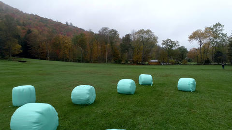 Aerial Drone - Fly Over Plastic Wrapped Bales of Hay in Fall in Vermont Footage