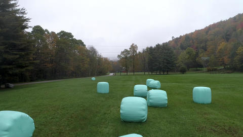 Aerial Drone - Skim Slowly Over Plastic Wrapped Bales of Hay in Fall in Vermont Footage