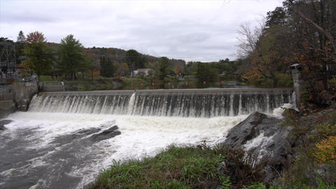 Slow Motion - River Flows Over Power Generating Dam In... Stock Video Footage