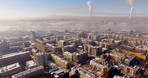 Flying on the copter over the winter city. Urban smog, on the horizon Live Action