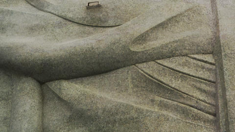 Pan of the exterior of Rio's monumental sculpture of Christ the Redeemer Footage