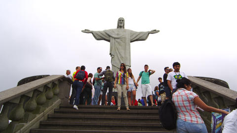 Slow motion tilt of tourists at the statue of Christ, Rio Footage