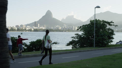 Pedestrians walking along Rio's Lagoa Footage