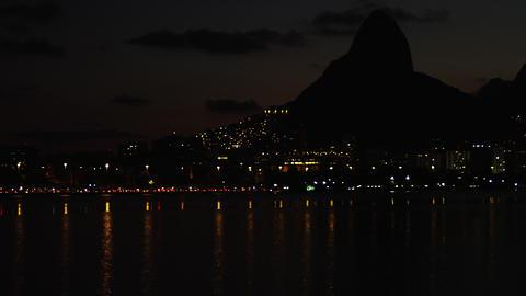 Slow night pan of Rio shoreline Footage