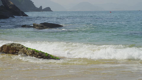 Slow motion of waves swirling ashore at Rio's Red Beach Footage