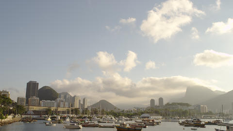 Pan of trees and clouds down to a marina in Guanabara Bay Footage