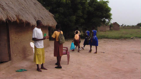 African kids walking between huts Footage