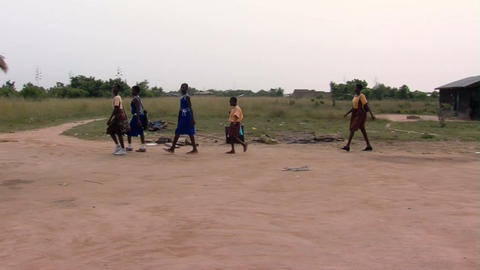 African children walking between huts Footage