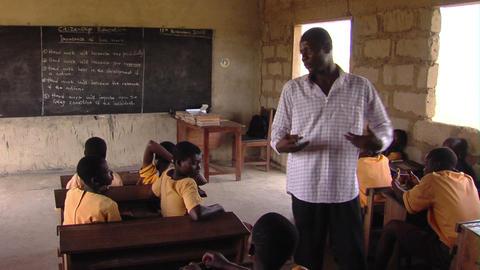 Teacher teaching in a classroom in Africa Footage